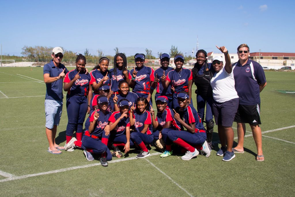 British West Indies Collegiate softball team 'The Spartans' in 2017 pose for their team photo in the Turks and Caicos Islands